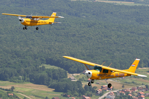 Our two canaries holding a nice, not-too-tight formation above the hilly Croatian countryside