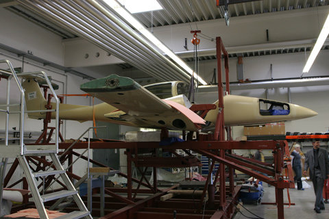 It all begins here. Composite materials like fiberglass (green) and carbon fibre (black) are moulded, shaped and impregnated separately before being put together into their final shape, as seen here. After this is complete, the aircraft will be disassembled again for painting and systems installation