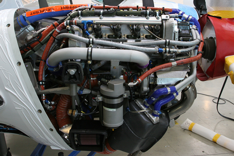 The Twin Star's piece de resistance - the Thielert Centurion 2.0 engine. Both the 1.7 and 2.0 develop the same 135 HP, the difference being in capacity - 1.7 vs 2.0 liters, far less than an equivalent avgas engine - and some changes to the turbocharger system. A condensed mass of wires and pipes, this is not a purpose-built aircraft engine, but a converted and heavily-modified Mercedes roadcar Diesel tweaked to accept more volatile Jet A fuel