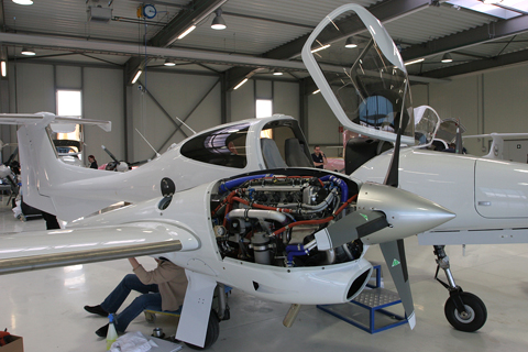 Final checks on another example. The grey stripes on the wing and stabilizers are the de-icing system elements