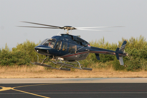 The aforementioned Bell 407. Notice the similar reg - HIT vs HTI, T and I being the initials of the owner, while H is the generic prefix for civil helicopters