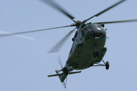 Mil Mi-8MTV-1, coded H-211, crossing low overhead during an ingress/egress practice session