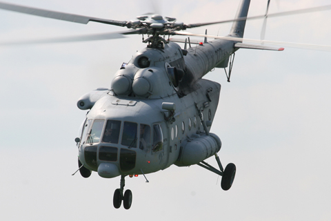 """A newer Mil Mi-171Sh blasts low over the field toward Gornja Stubica to catch its display slot. Unlike the stock airforce Mi-8MTV-1s, the -171Sh - Sh for """"shturmovoj"""", or attack - can carry four B8V 80 mm rocket packs under removable pylons. Only equipped as such once - during their unveiling ceremony - they now mostly fly completely unarmed"""