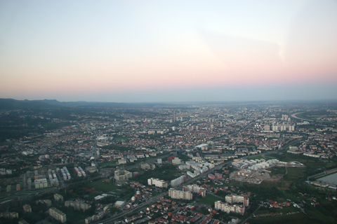 Climbing through about 1,500 feet toward the district of Črnomerec in the western part of town, with the sun just about to set