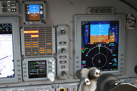 The copilot's side, with the other PFD, radios and announciatior panel