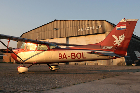 """One of my """"Aviation Legends"""" photos, picturing famous aircraft types - all two I ever found parked in front of the hangar :) - against the most distinctive fixture of Lučko. Shot before I even knew that this hangar predates even the first versions of the planes shot :)"""