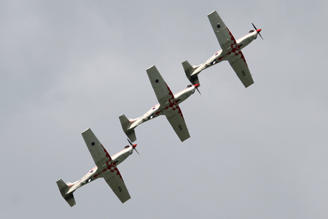 Flying follow the leader in perfect symmetry. At various points during their mass maneuvers, the aircraft are less than 2 meters apart