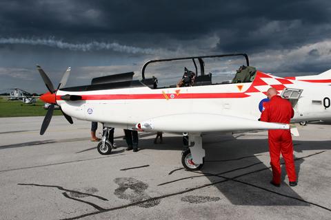 062 ticks itself cool under a dramatic sky as Damir Barišić, the Krila Oluje lead, packs the plane up