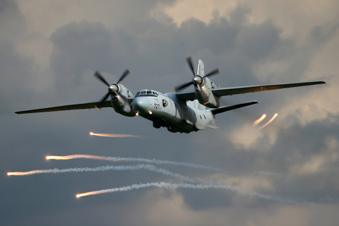 One of the stars of the show, the CroAF Antonov An-32B, firing off flares during a low pass