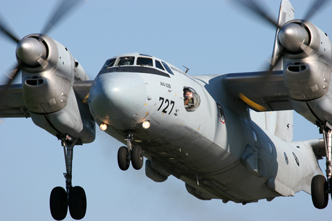 With its high.mounted engines, the An-32 is certainly a powerful sight. The navigator seems to be having fun :)