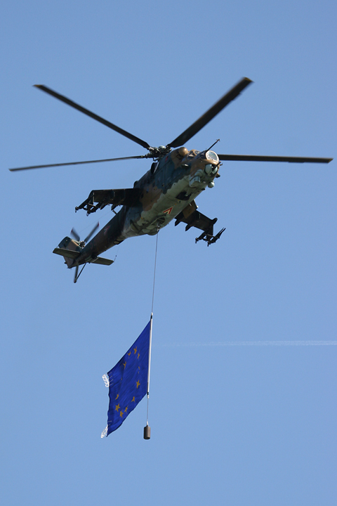 Right on its tail were two - more aggressive - Mil Mi-24V gunships, flying the NATO and EU flags