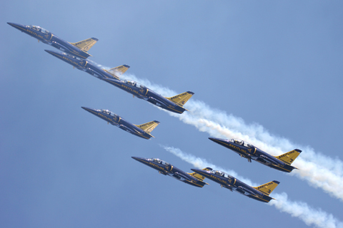 Flying through their own smoke during a mass formation maneuver. The world's first all-jet civilian display team, the BJT is composed entirely of former French Air Force pilots - some with flight hours running into 5 digits