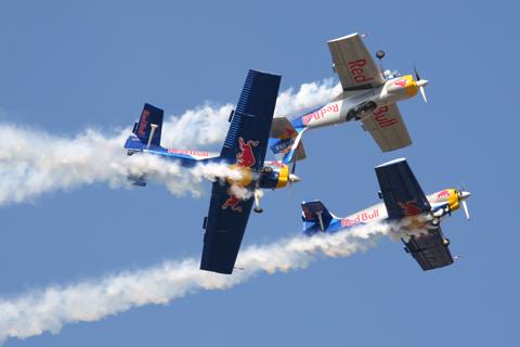 The Flying Bulls' trademark maneuver - a barrel roll around the mirror flight duo