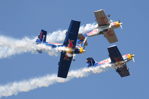 The Flying Bulls' trademark maneuver - a barrel roll around the mirror flight duo