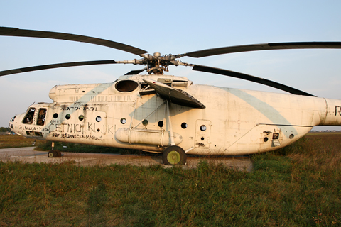 Up closer, the size of the Mi-6 becomes more apparent, when you can compare it to known details such as doors and windows. Like most Soviet helicopters, the Mi-6 carries its fuel tanks externally, seen here strapped to the mid fuselage
