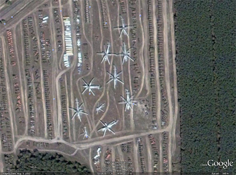 The Chernobyl vehicle graveyard, with several Mi-6s clearly visible - they can hardly fail to be given their size. The image coordinates are: N51° 09' 15.42'' E029° 58' 59.68''