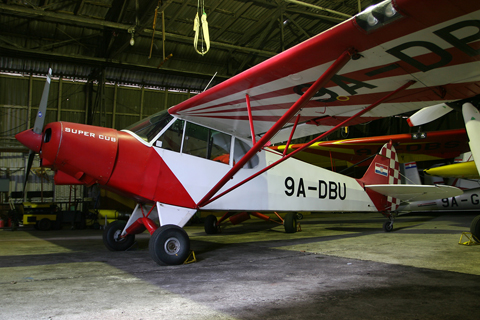 Despite it still being light outside - plenty of it between the storm clouds - we had lit up the interior as well :). A stock Super Cub, 9A-DBU is one of a number of such aircraft bought and imported at pretty much the same time for towing duties