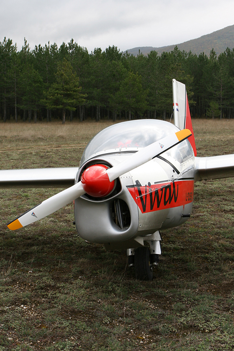 A rare motorglider, a pine forest in the back, hills and low cloud - what more could you ask for an interesting photo? :)