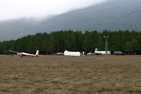 With some beautiful scenery in the back, 9A-DSI is seen waiting for the wind to subdue a bit. The other two gliders, a standard L-13 and a Pirat, didn't even bother getting off their trailers :)