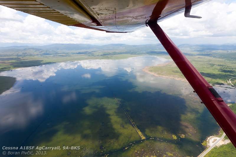 """An overflight of what my colleague flying had eloquently termed the """"Krbavian Sea"""" . Neither a man-made nor permanent geographic feature, this temporary lake was created by the abundant rains that had hit the Krbavsko polje area over the past few weeks."""