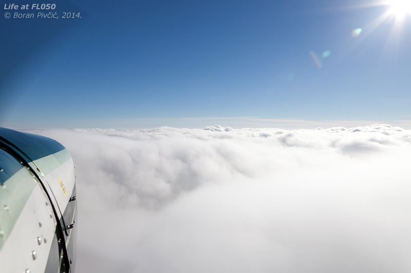 A large, unbroken stratus, beautiful sunshine on top, a light aircraft and a camera - what more could one want to be content?  (except a pair of gloves) Skirting the edge of an extensive sheet of stratus as the perfect cap to the whole flight.