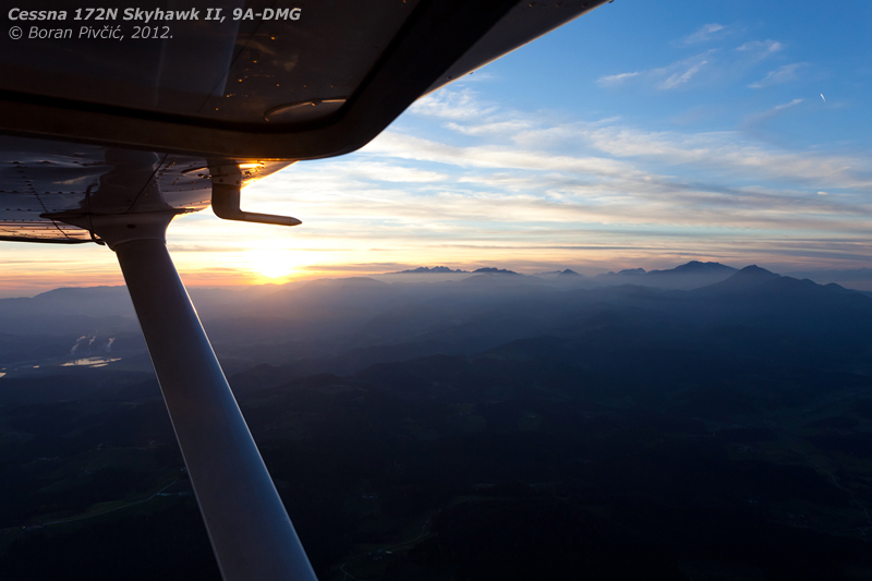 Enjoying the fresh breeze at 5,000 ft as we rumble northwards above Slovenia. Pretty soon we'd turn west towards the Julian Alps - visible in the distance - where we'd pop up to 7,000 and switch to IFR for our night-time return home.