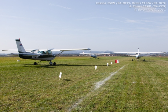 The first group of competitors (minus C150 9A-DMI standing to my left) prepares for take-off down RWY 28L. Since they were departing individually, for reasons of safety the lead ship had to be the fastest of the group - C172 9A-DFH - with the three slower C150s at the back sequenced by their pilots' precedence on the competition roster. Of note, since the competition field took up half the width of the runway, all competitors had to take off from an intermediate position - roughly 200 meters from the threshold - to avoid blowing the flags and lime away...