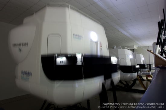 A view of just part of ONE OF the simulator halls at the FSI training center, located at the northern end of Farnborough Airport. With space for five units, this hall contains devices for the King Air B200 (where a party is currently in progress), Hawker 400XP and the Dash 8 Q400, with a Gulfstream 450/550 located behind me. There's also a separate hall reserved solely for various Citation models - and another which contains, among others, units for the Sikorsky S-92 Helibus and the C-17 Globemaster.