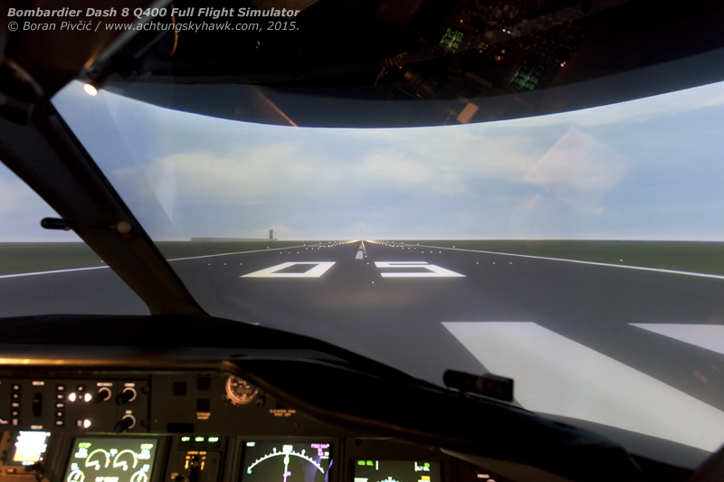 An important part of every simulator and FNPT is the visual system, which is responsible for the view outside. The Vital 9 unit used for the Dash 8 FFS provides a field of view of 180 degrees horizontally and 40 degrees vertically, with the picture provided by three cross-mounted projectors located on the top of the cab. And while the graphics quality may be inferior even to PC-based games, for training purposes it is more than enough, since most of the time the crew need look out only on take-off, approach and landing (where the runway and its lighting systems are the most important cues).