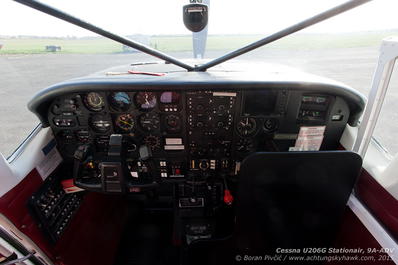 In addition to a full IFR suite w/ autopilot, the nicely equipped panel also includes several useful features for skydive ops, including a moving-map GPS (great for putting the jumpers right on target), EGT and CHT gauges (to avoid overheating the engine during prolonged high-power climbs in hot weather) - as well as a stormscope for avoiding summer CBs common in the region. An interesting detail are the two windshield crossbeams, a leftover from ADV's seaplane days (also my apologies for the glare, the sun was low and I couldn't bear to nag with re-orientating the aircraft).