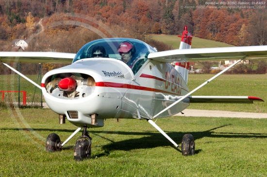 """A small, odd airplane + parked on grass with muddy tires + a background of rolling hills and autumn colors = love at first sight. The irreplaceable magic of light aviation in one photo as """"Alpendohle"""" warms up its engine for departure from Novo Mesto. A design that tends to raise some eyebrows, the BO-208 is actually a German-built version of the Swedish MFI-9, created at the end of the 50s as a light touring aircraft with utility potential. Even though it is pretty obscure today, the MFI-9 was also the basis for the larger and more powerful SAAB MFI-15 Supporter, which is still used for training duties by several Scandinavian air forces..."""