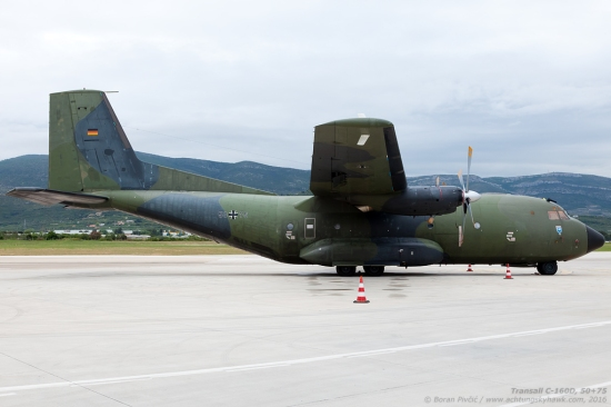 "While the high wing, underslung turboprops, large tires and a rear loading ramp are nowadays a common configuration for light and medium tactical transports, this profile was still a novelty with the Transall entered service in the mid-60s. One of the most stubbornly long-lived transport aircraft ever made, the C-160 is also among the earliest instances of post-WW2 European cooperation, having come about as a joint project between France and Germany. With uninterrupted service spanning five decades, the Transall is still actively flying in France, Germany and Turkey - and had already in 2001 clocked up one million flying hours. Of interest, the Transall name is an amalgamation of ""Transporter Allianz"" - while the 160 is its wing area in square meters. 50+75 itself - pictured here at Split Airport (SPU/LDSP) - is one of the last first-generation examples (mfd. in 1971), and had visited on occasion of a multinational military exercise."
