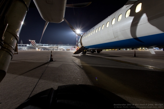 When you don't have a tripod on you, you have to use whatever you have at hand - even a main gear tire! CQA is seen waiting about for one of its last flights of the day as company traffic further out prepares to taxi out for a short hop north.