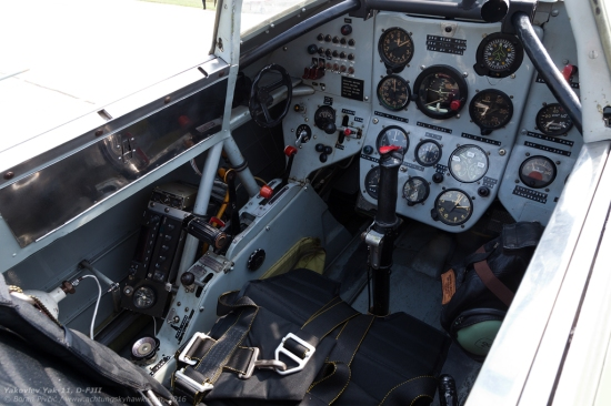 A peek into the front cockpit. While they may be unusual by today's standards, the ergonomics and layout of the panel do have some interesting touches: the dominating artificial horizon intended for easy reading during aerobatics or instrument flight; the engine gauges grouped generally out of view, but tilted upwards toward the pilot; and all system and navigation controls set within reach of the left hand.